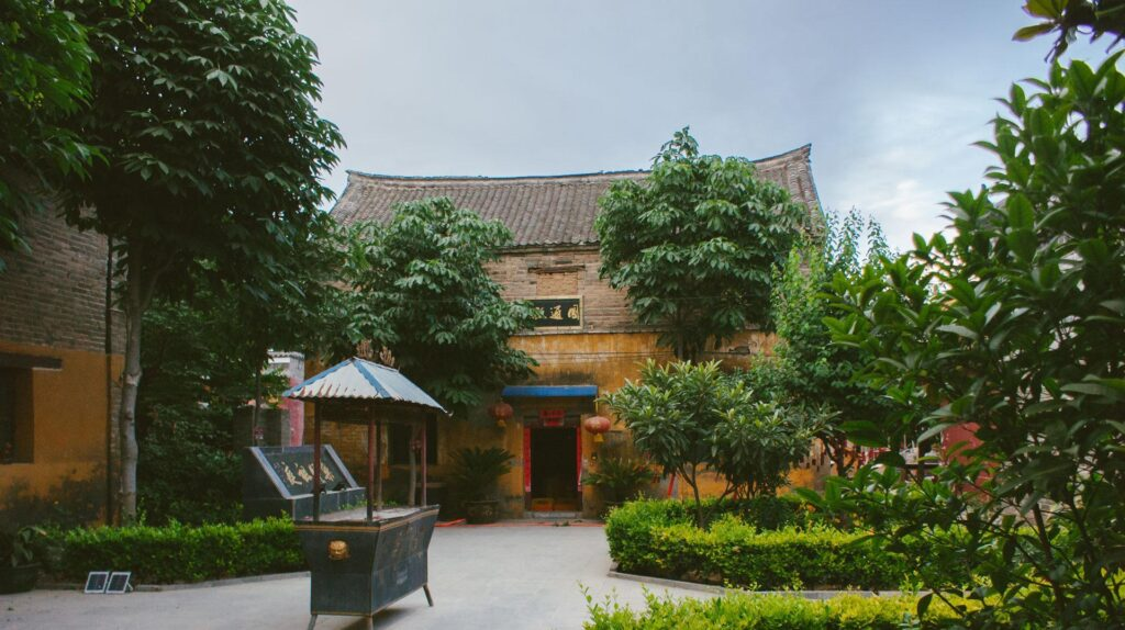 the courtyard of the monastery where the monks are engaged in kung fu