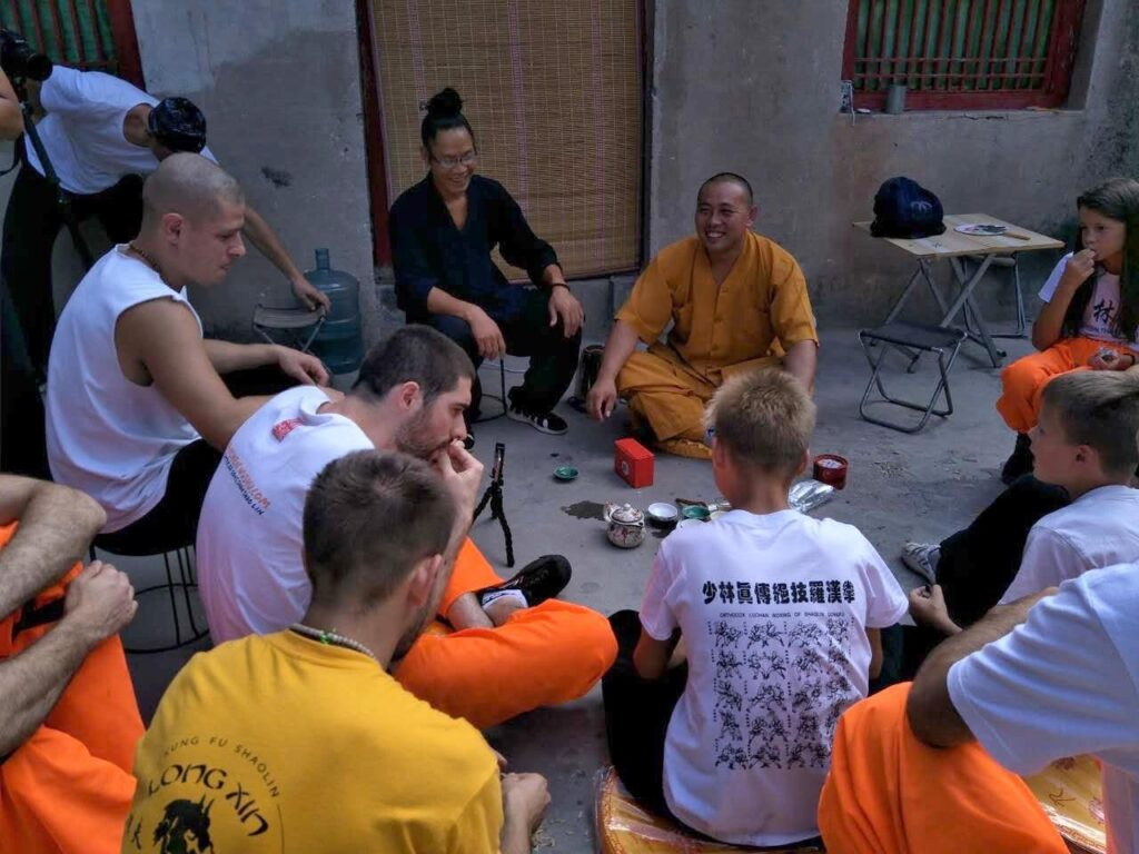 tea ceremony on the floor with a master monk of the Shaolin monastery